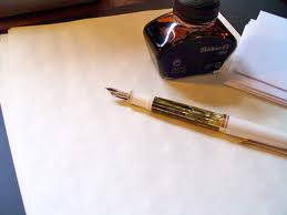 Letter paper, with ink pen and ink bottle